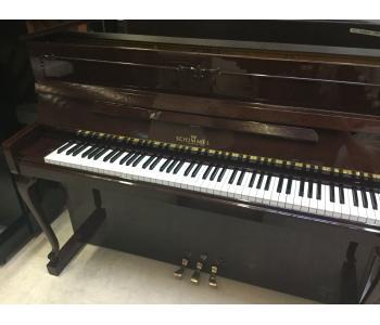 Piano droit SCHIMMEL 112 chippendale acajou brillant